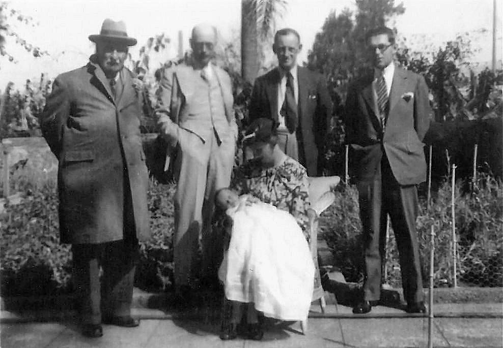The eccentric Osbert, with his homburg hat and long overcoat, is pictured at the christening of a Library member in 1938. Osbert was 82 by then.